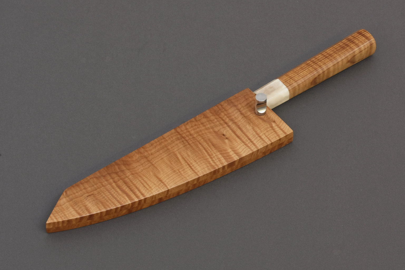 Nakama knife from Guldimann with a handle and sheath from Bijouwood flamed maple