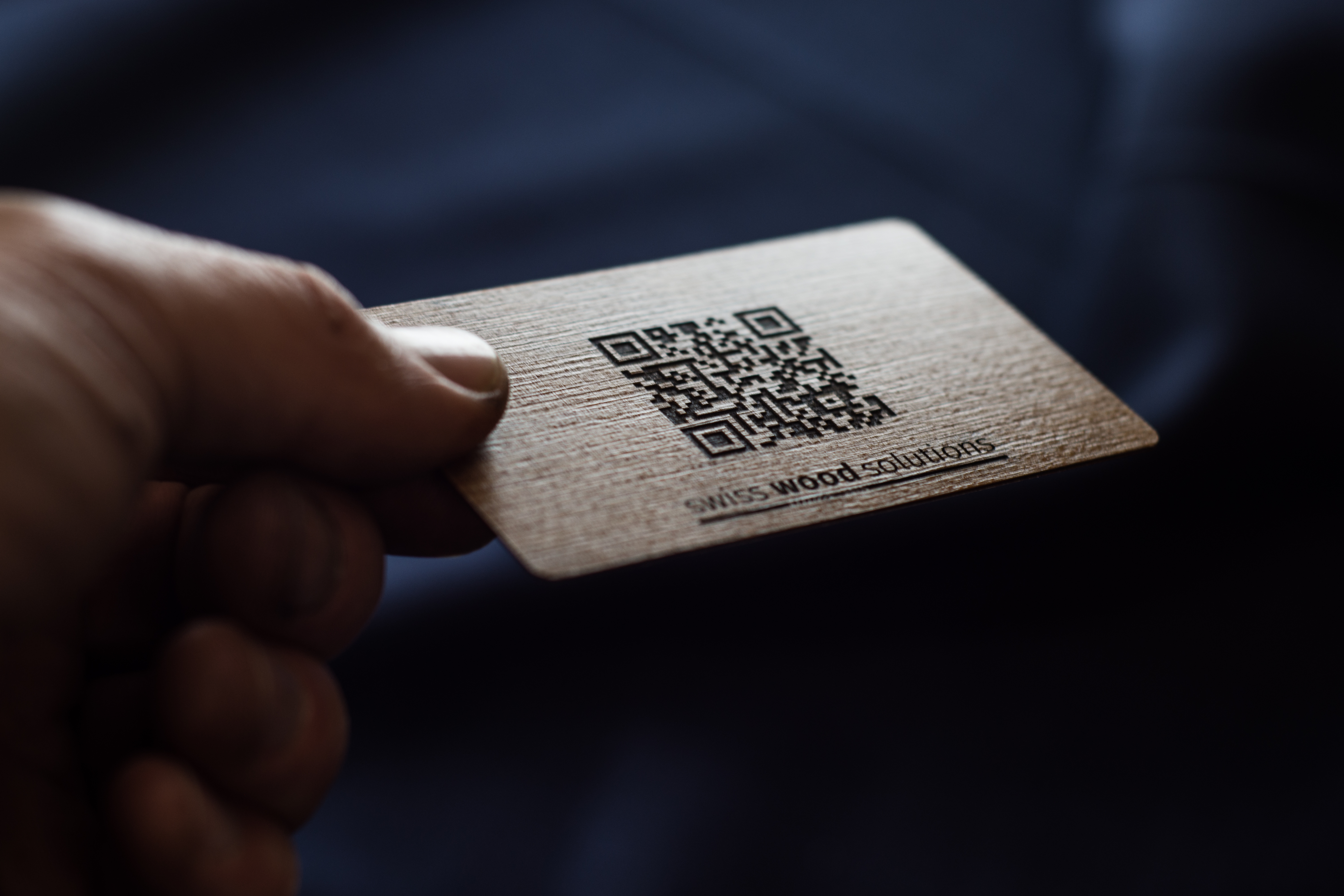 Swiss Wood Solutions business card with QR code from maple wood