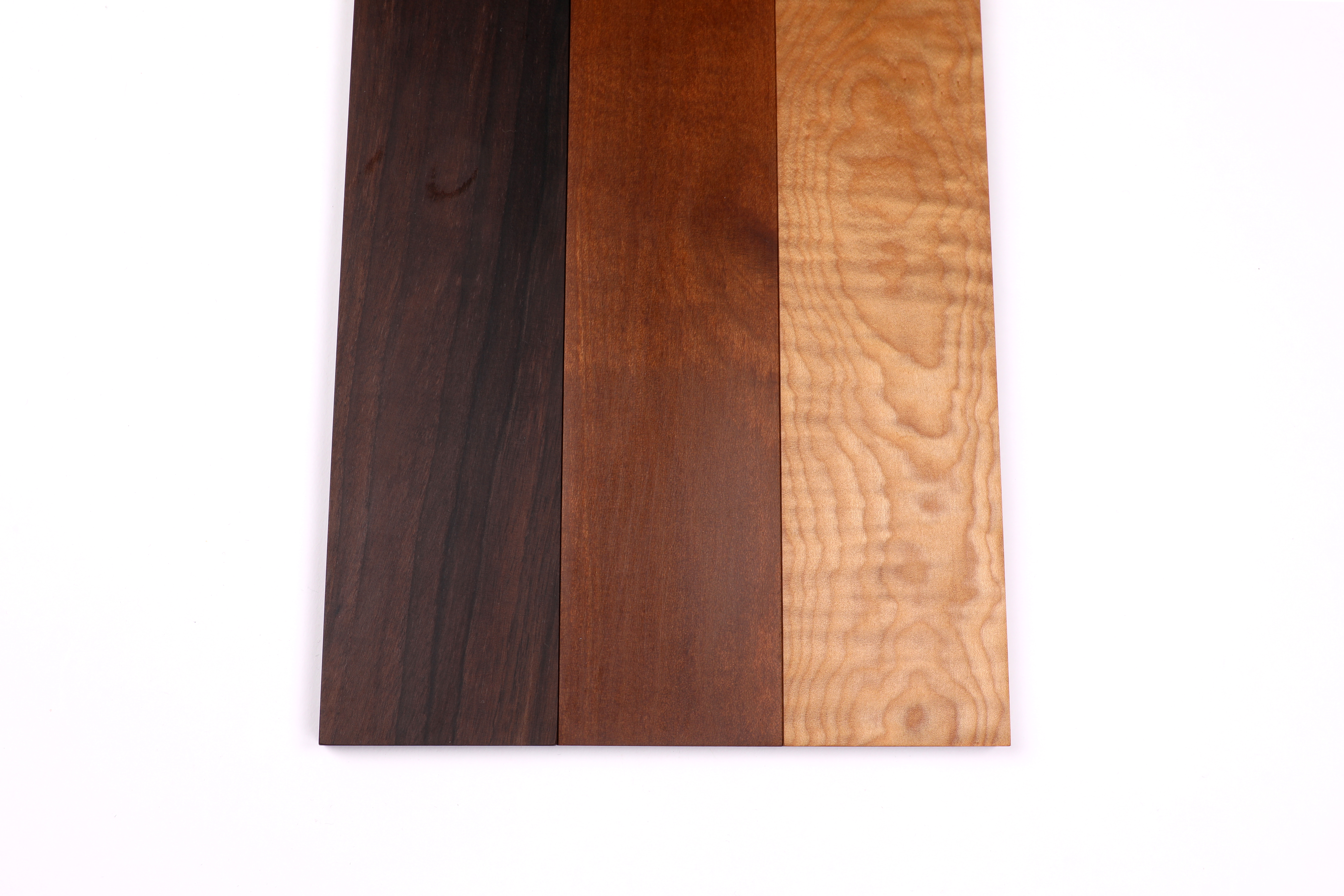 Fretboards from Sonowood walnut (left), maple (center) and flamed maple (right)