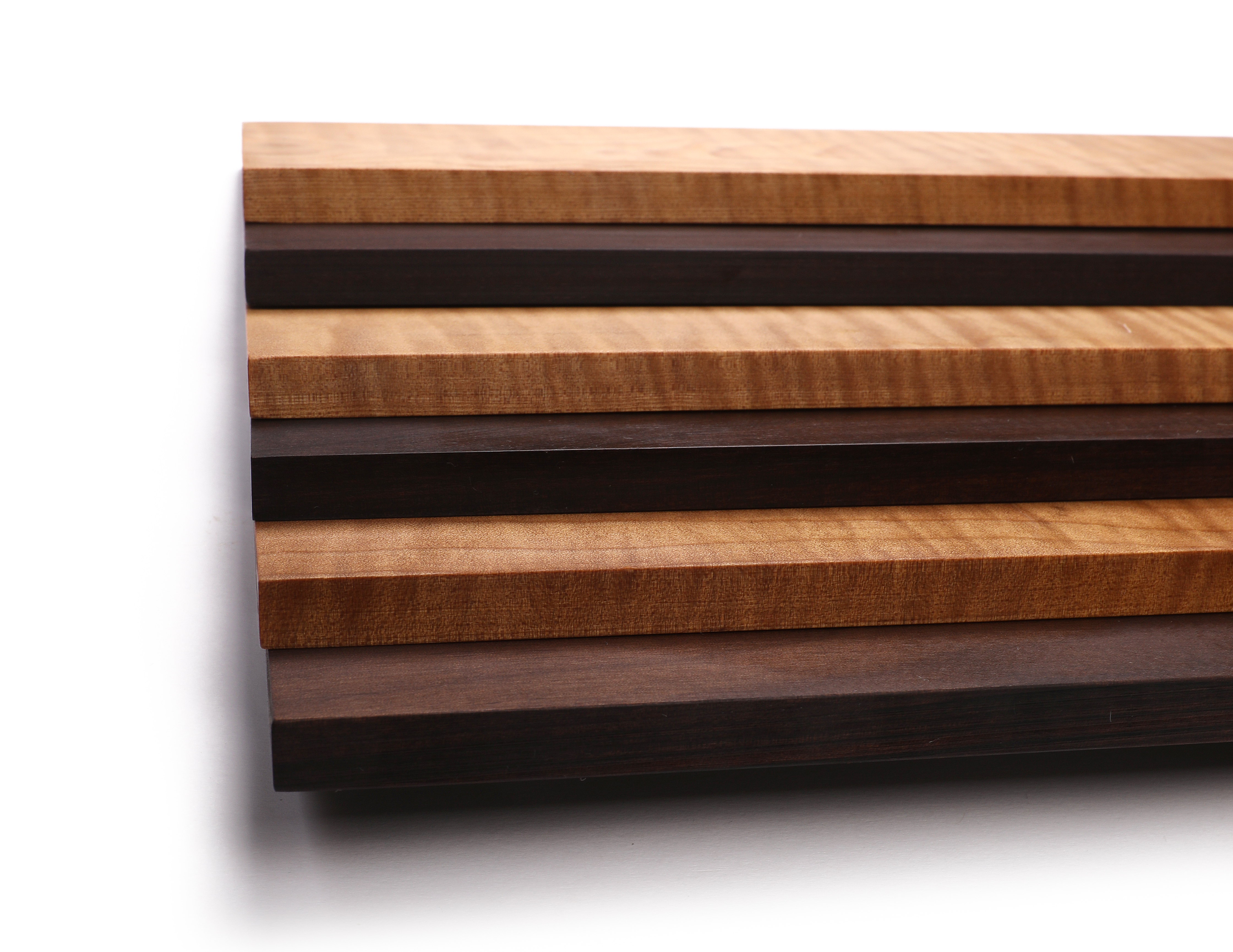 Fretboards from Sonowood flamed maple, maple and walnut